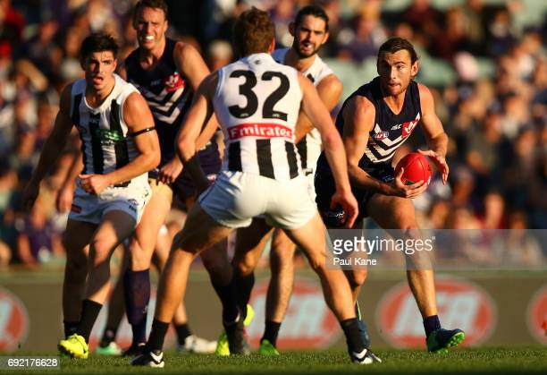 Connor Blakely of the Dockers looks to pass the ball during the round 11 AFL match between the Fremantle Dockers and the Collingwood Magpies at...
