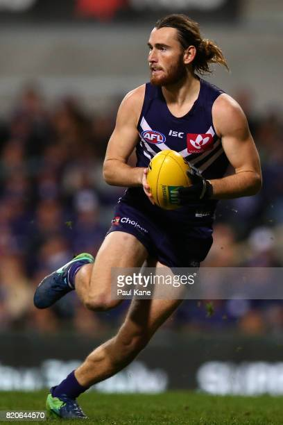 Connor Blakely of the Dockers looks to pass the ball during the round 18 AFL match between the Fremantle Dockers and the Hawthorn Hawks at Domain...