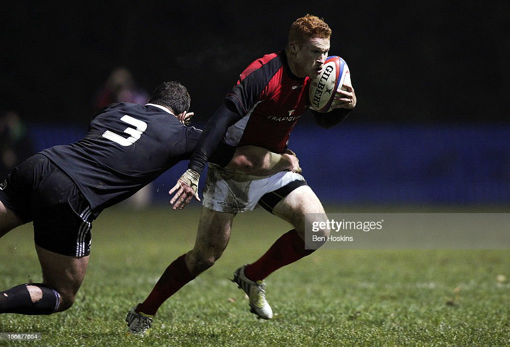 Connor Braid of Canada is tackled by Ben May of the Maori All Blacks during a tour match between Canada and Maori All Blacks at Oxford University Rugby Club on November 23, 2012 in Oxford, England.