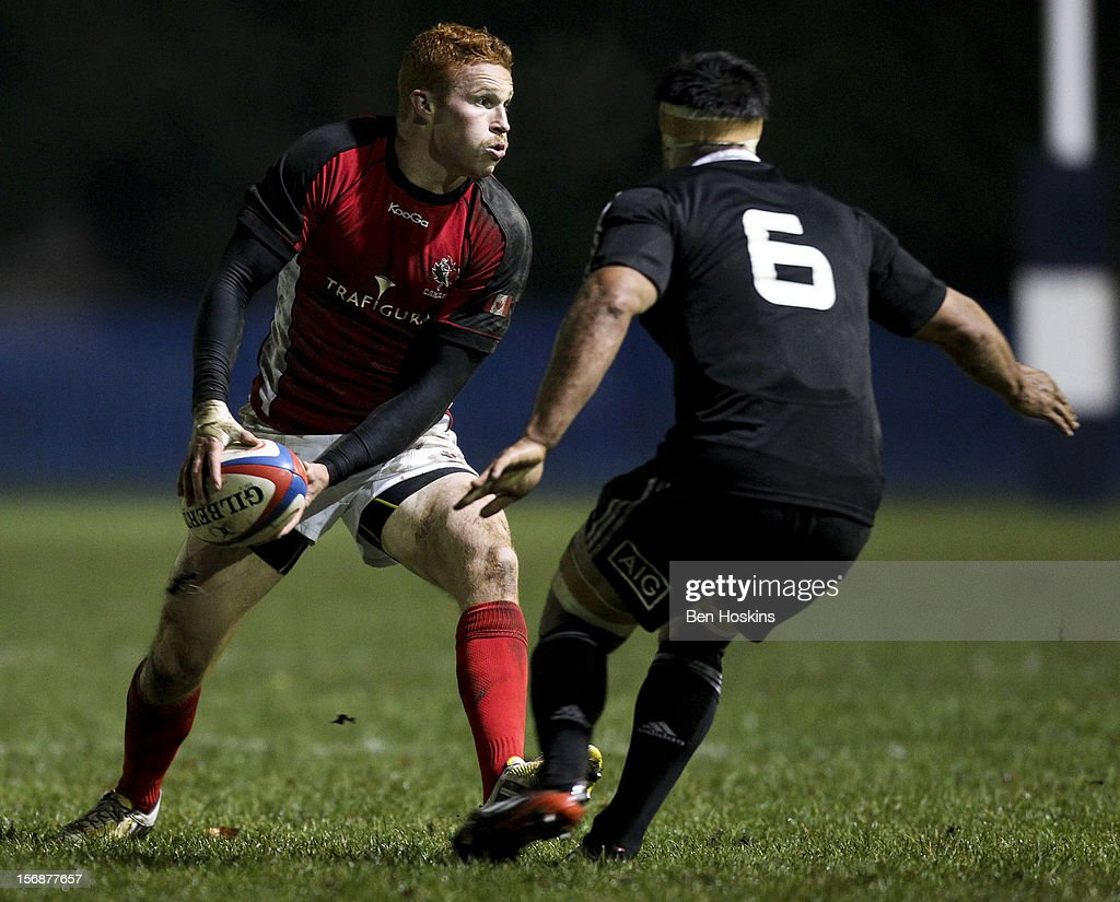 Connor Braid of Canada looks to pass ahead of Shane Christie of the Maori All Blacks during a tour match between Canada and Maori All Blacks at Oxford University Rugby Club on November 23, 2012 in Oxford, England.