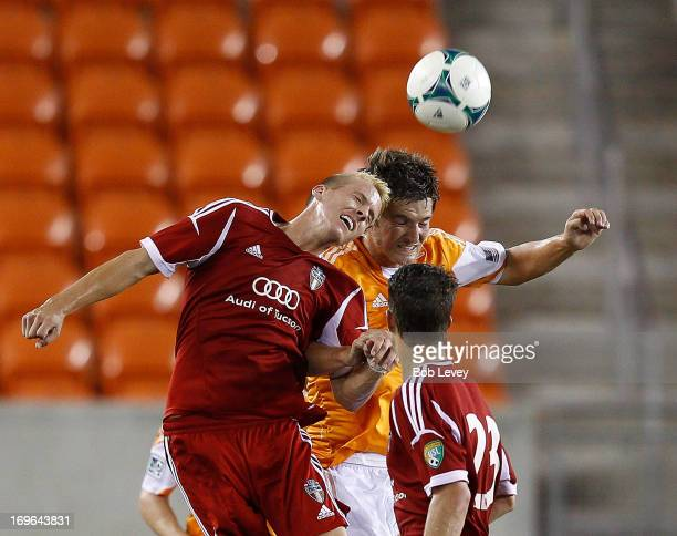 Connor Brandt of FC Tuscon and Bobby Boswell of Houston Dynamo go up for a header at BBVA Compass Stadium on May 29 2013 in Houston Texas
