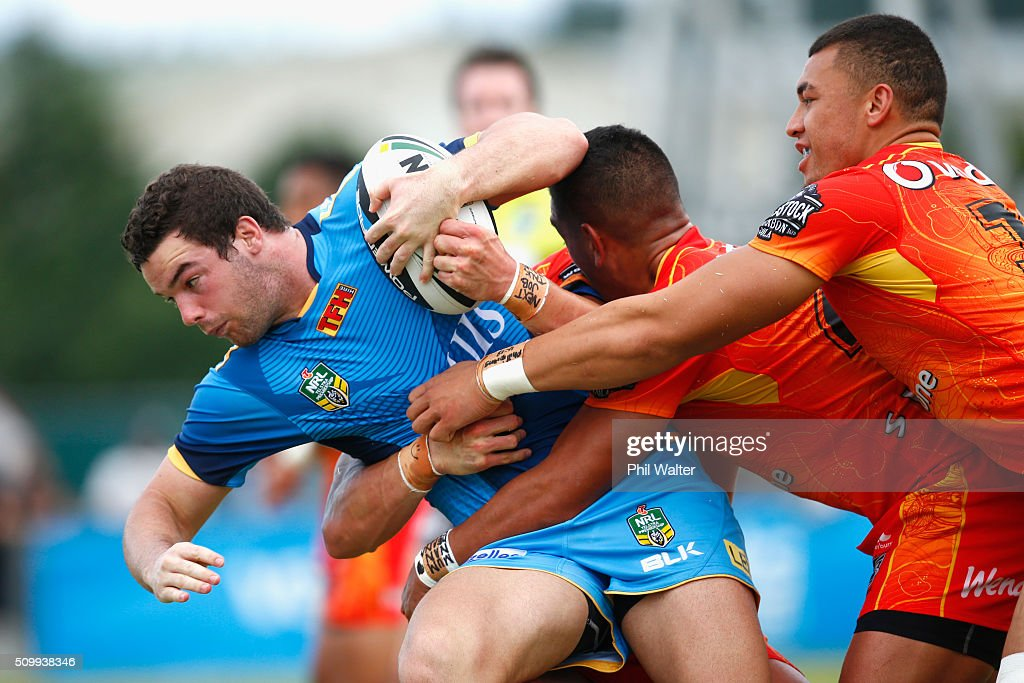 Connor Broadhurst of the Titans is tackled during the NRL Trial Match between the New Zealand Warriors and the Gold Coast Titans at Toll Stadium on February 13, 2016 in Whangarei, New Zealand.
