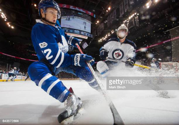 Connor Brown of the Toronto Maple Leafs and Julian Melchiori of the Winnipeg Jets play during the first period at the Air Canada Centre on February...