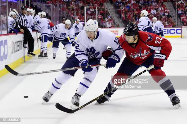 Connor Brown of the Toronto Maple Leafs and Kevin Shattenkirk of the Washington Capitals battle for the puck in the second period in Game Five of the...