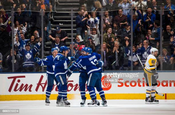 Connor Brown of the Toronto Maple Leafs celebrates his game winning goal with teammates Leo Komarov Jake Gardiner and Nazem Kadri as Phil Kessel of...