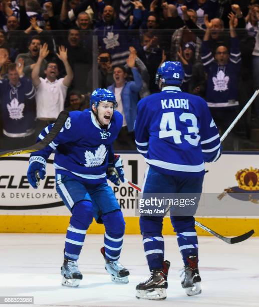 Connor Brown of the Toronto Maple Leafs celebrates his game winning goal against the Pittsburgh Penguins with Nazem Kadri during the third period at...