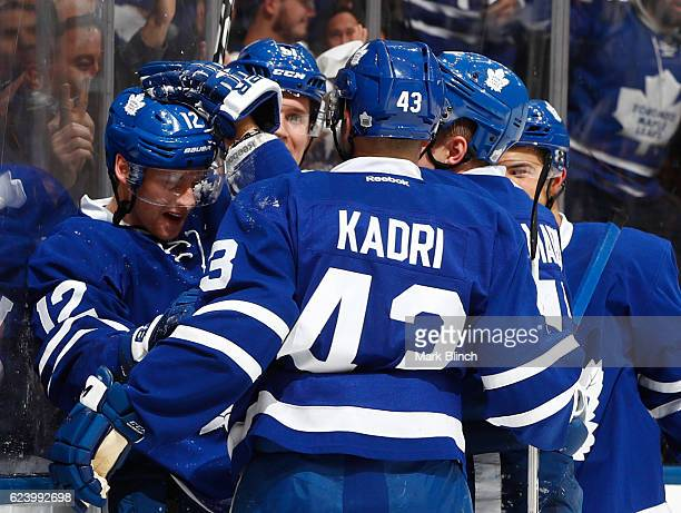 Connor Brown of the Toronto Maple Leafs celebrates his goal against the Florida Panthers with his line mates during the first period at the Air...