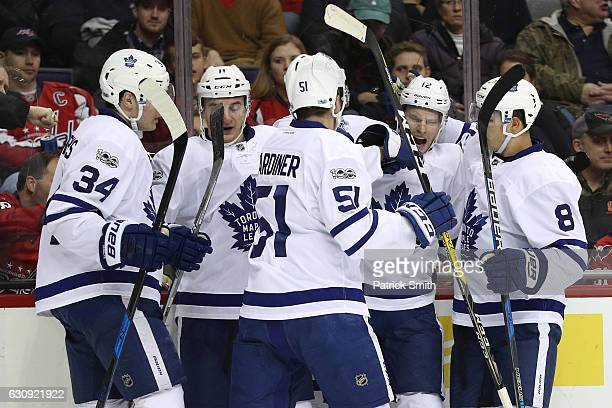 Connor Brown of the Toronto Maple Leafs celebrates his goal with teammates against the Washington Capitals during the first period at Verizon Center...