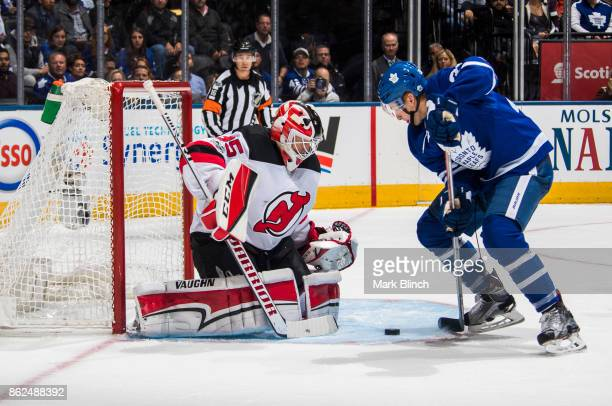 Connor Brown of the Toronto Maple Leafs goes to the net against Cory Schneider of the New Jersey Devils during the first period at the Air Canada...