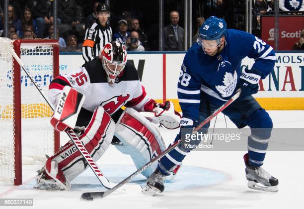 Connor Brown of the Toronto Maple Leafs looks for a shot on Cory Schneider of the New Jersey Devils during the first period at the Air Canada Centre...