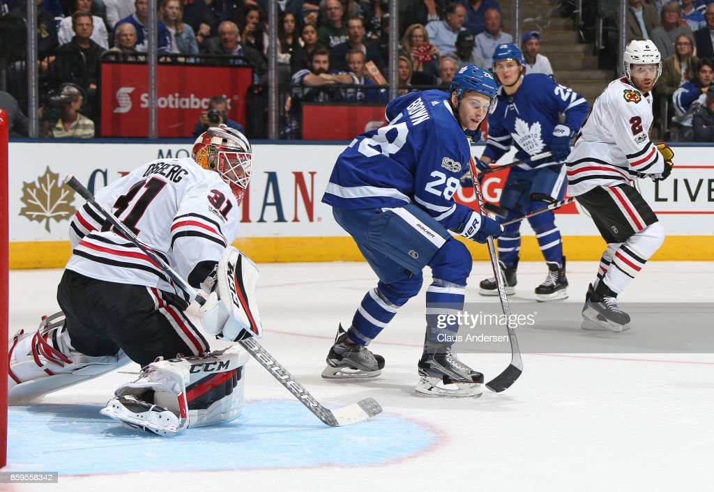 Connor Brown #28 of the Toronto Maple Leafs looks to tip a shot in front of Anton Forsberg #31 of the Chicago Blackhawks skates against the Toronto Maple Leafs in an NHL game at the Air Canada Centre on October 9, 2017 in Toronto, Ontario. The Maple Leafs defeated the Blackhawks 4-3 in overtime