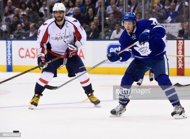 Connor Brown of the Toronto Maple Leafs makes a pass in front of Alex Ovechkin of the Washington Capitals during the third period at the Air Canada...