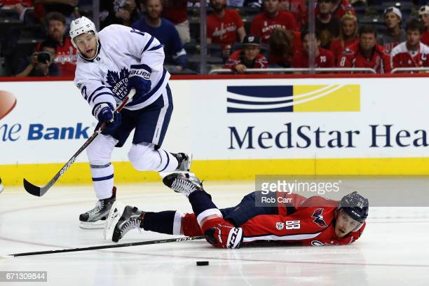 Connor Brown of the Toronto Maple Leafs passes the puck past Nate Schmidt of the Washington Capitals in the first period in Game Five of the Eastern...