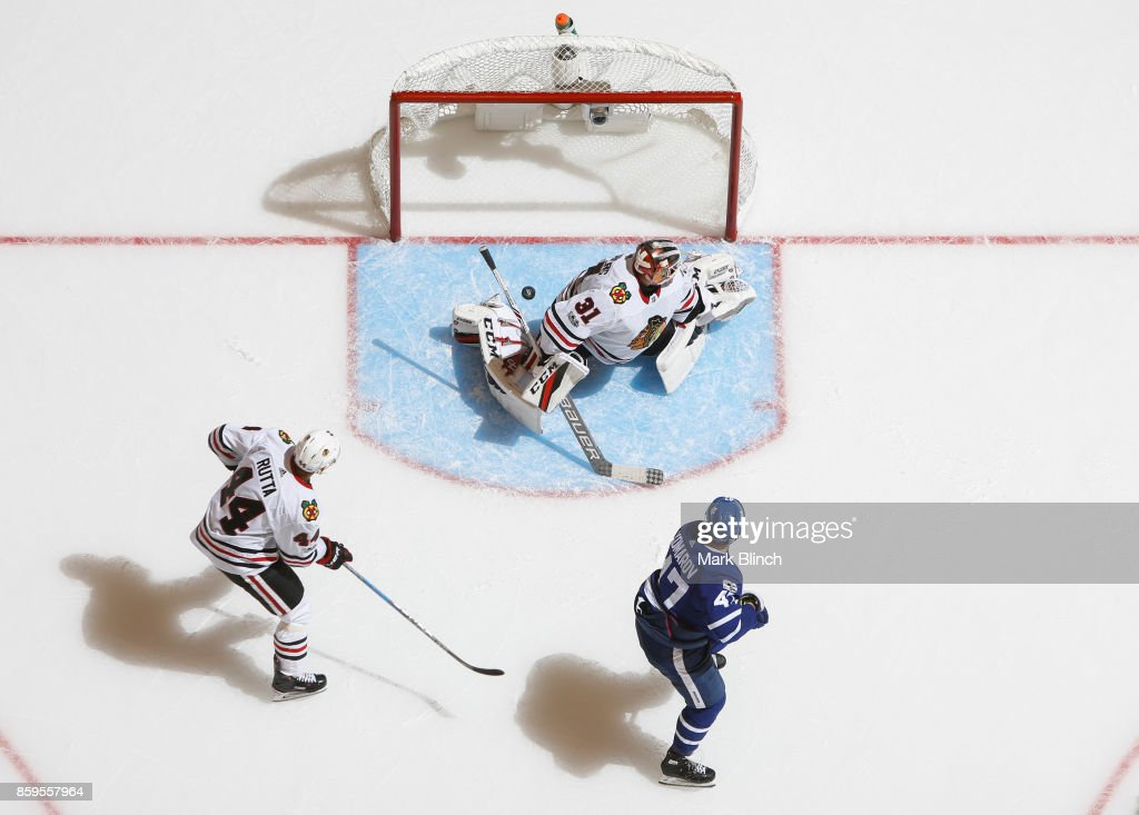 Connor Brown #28 of the Toronto Maple Leafs scores on Anton Forsberg #31 of the Chicago Blackhawks as Jan Rutta #44 of the Chicago Blackhawks during the third period October 9, 2017 at the Air Canada Centre in Toronto, Ontario, Canada.