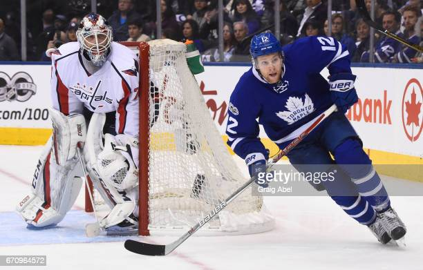 Connor Brown of the Toronto Maple Leafs skates past Braden Holtby of the Washington Capitals during the first period in Game Three of the Eastern...