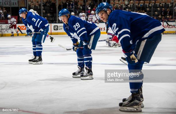 Connor Brown William Nylander and Alexey Marchenko of the Toronto Maple Leafs take part in warm up prior to the game against the New York Rangers at...