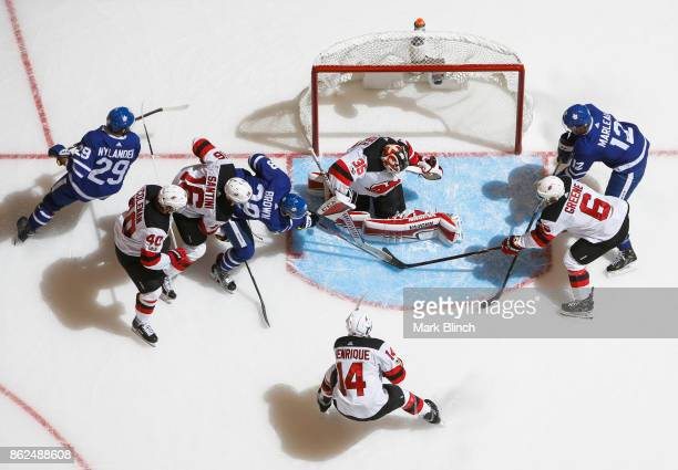 Connor Brown William Nylander and Patrick Marleau of the Toronto Maple Leafs go to the net against Cory Schneider Andy Greene Adam Henrique Steven...