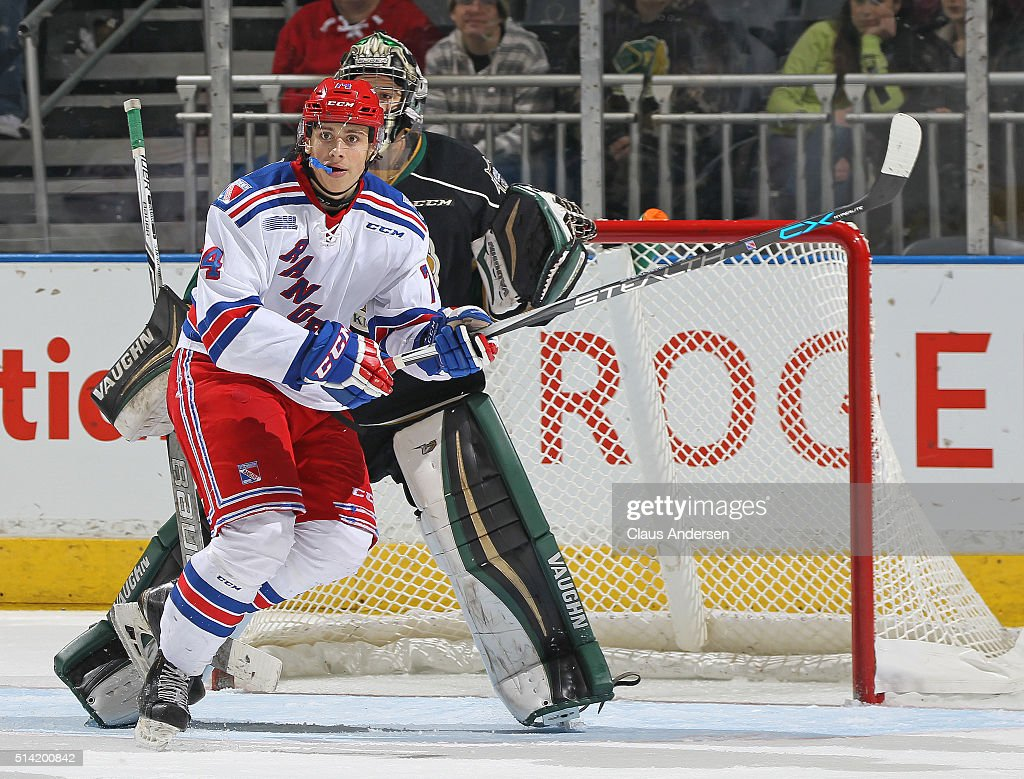 Connor Bunnaman #74 of the Kitchener Rangers skates in front of Tyler Parsons #1 of the London Knights during an OHL game at Budweiser Gardens on March 6, 2016 in London, Ontario, Canada. The Knights defeated the Rangers 4-1.