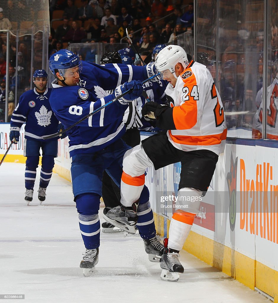 Connor Carrick #8 of the Toronto Maple Leafs checks Matt Read #24 of the Philadelphia Flyers during the third period at the Air Canada Centre on November 11, 2016 in Toronto, Canada. The Maple Leafs defeated the Flyers 6-3.
