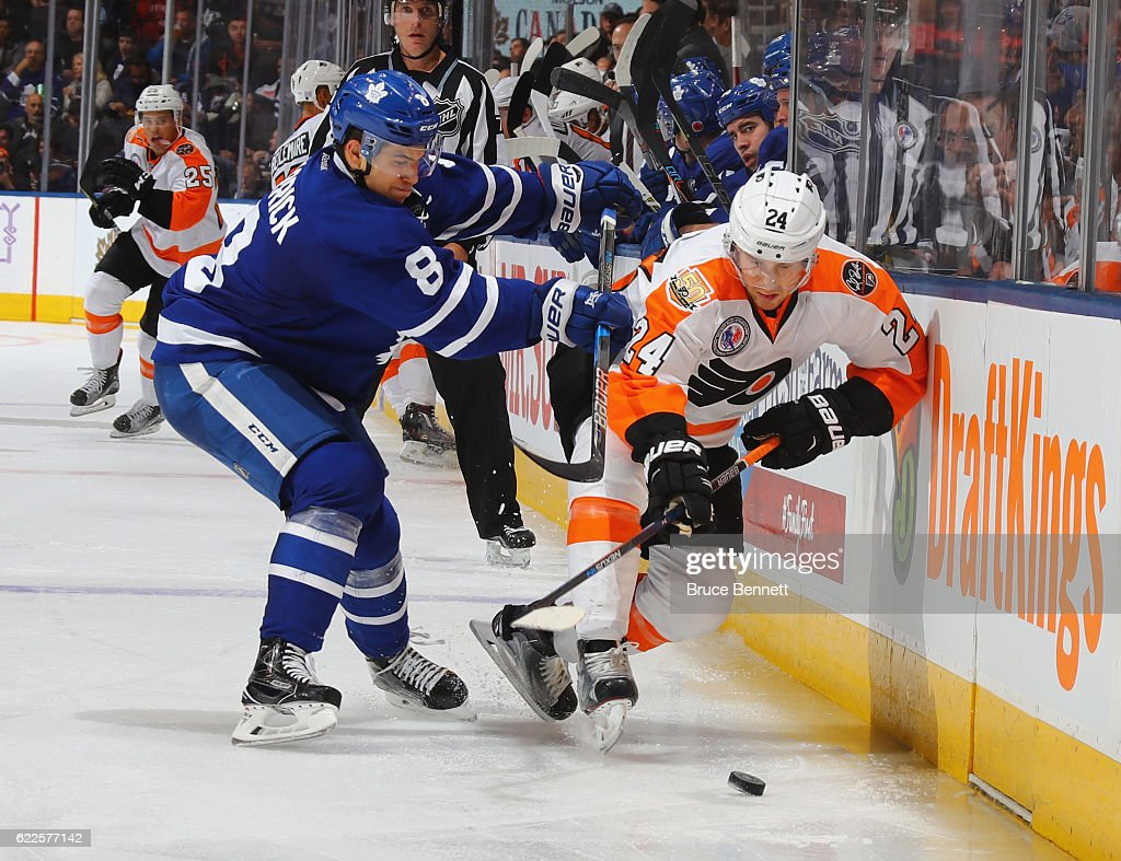 Connor Carrick #8 of the Toronto Maple Leafs checks Matt Read #24 of the Philadelphia Flyers at the Air Canada Centre on November 11, 2016 in Toronto, Canada. The Maple Leafs defeated the Flyers 6-3.