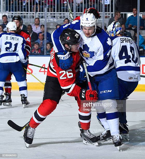 Connor Carrick of the Toronto Marlies battles with Ben Thomson of the Albany Devils during 2nd round AHL playoff game action on May 4 2016 at Ricoh...