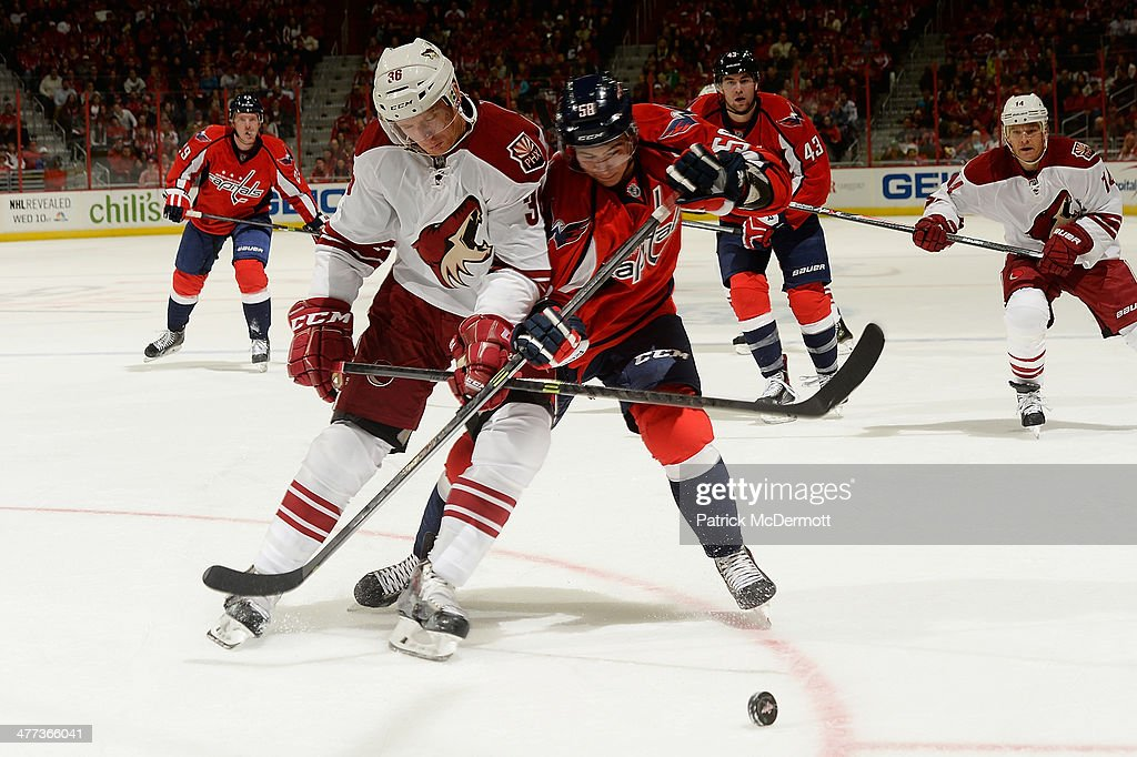 <a gi-track='captionPersonalityLinkClicked' href=/galleries/search?phrase=Connor+Carrick&family=editorial&specificpeople=9491429 ng-click='$event.stopPropagation()'>Connor Carrick</a> #58 of the Washington Capitals and <a gi-track='captionPersonalityLinkClicked' href=/galleries/search?phrase=Rob+Klinkhammer&family=editorial&specificpeople=2127064 ng-click='$event.stopPropagation()'>Rob Klinkhammer</a> #36 of the Phoenix Coyotes battle for the puck in the third period during an NHL game at Verizon Center on March 8, 2014 in Washington, DC.