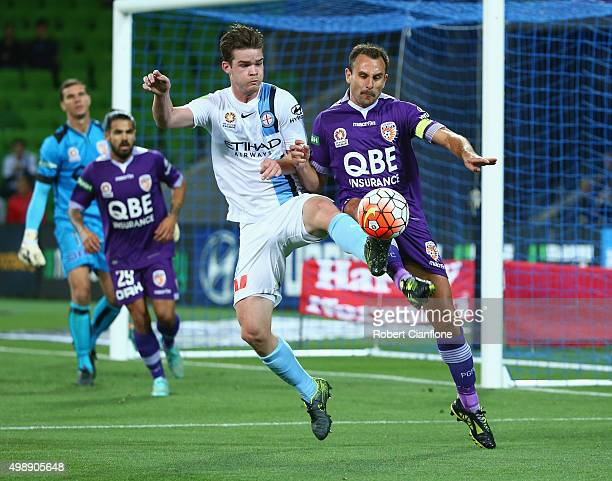 Connor Chapman of Melbourne City challenges Richard Garcia of Perth Glory during the round eight ALeague match between Melbourne City FC and Perth...
