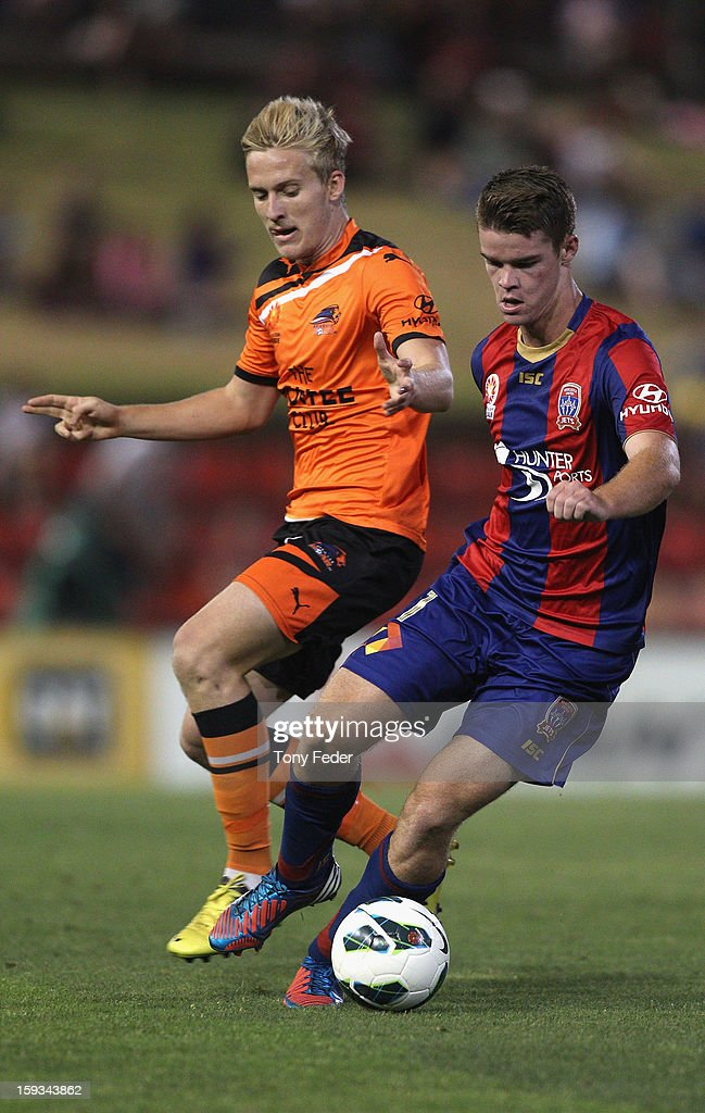 Connor Chapman of the Jets contests the ball with Ben Halloran of the Roar during the round 16 A-League match between the Newcastle Jets and the Brisbane Roar at Hunter Stadium on January 12, 2013 in Newcastle, Australia.