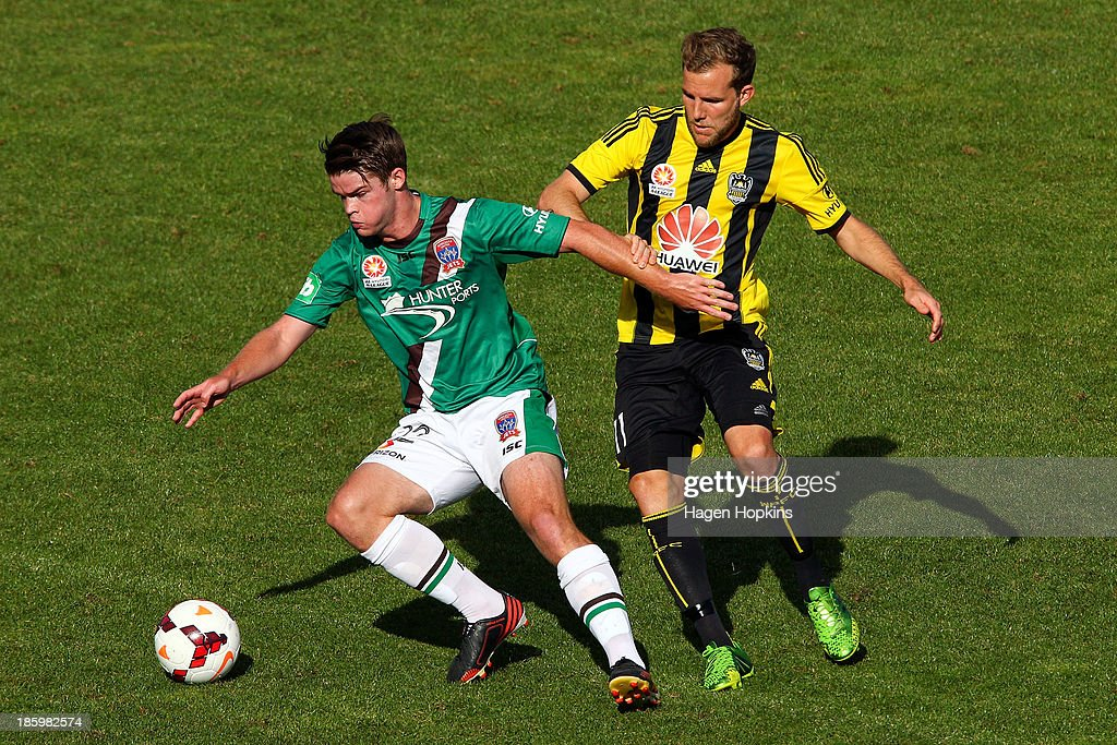 Connor Chapman of the Jets holds off the defence of Jeremy Brockie of the Phoenix during the round three A-League match between Wellington Phoenix and the Newcastle Jets at McLean Park on October 27, 2013 in Napier, New Zealand.