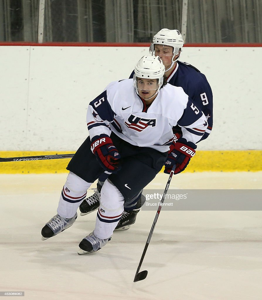 Connor Clifton #5 of USA White skates against USA Blue during the 2014 USA Hockey Junior Evaluation Camp at Lake Placid Olympic Center on August 2, 2014 in Lake Placid, New York.