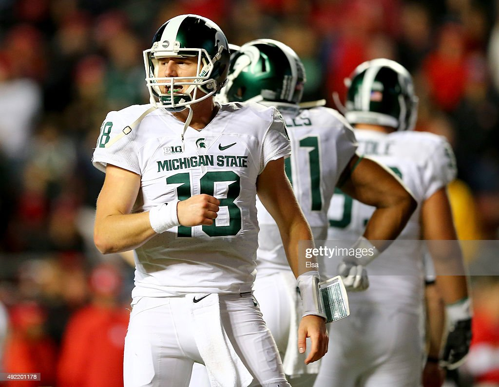 Connor Cook of the Michigan State Spartans celebrates a touchdown in the fourth quarter against the Rutgers Scarlet Knights on October 10 2015 at...