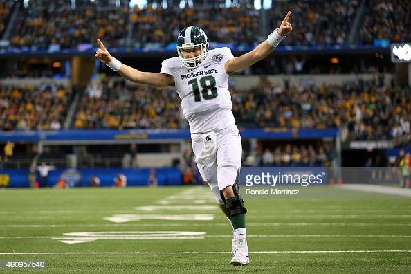 Connor Cook of the Michigan State Spartans celebrates after the Spartans score a touchdown against the Baylor Bears during the first half of the...