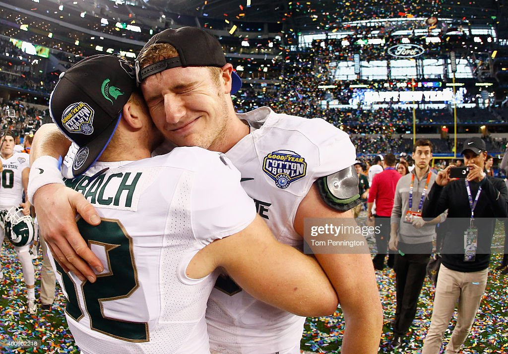 Connor Cook of the Michigan State Spartans celebrates with Zac Leimbach of the Michigan State Spartans after the Spartans beat the Baylor Bears 4241...