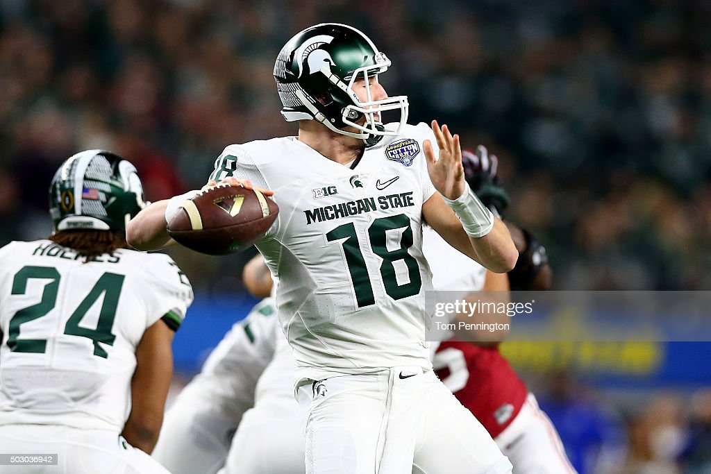 Connor Cook of the Michigan State Spartans looks to pass against the Alabama Crimson Tide in the first quarter of the Goodyear Cotton Bowl at ATT...