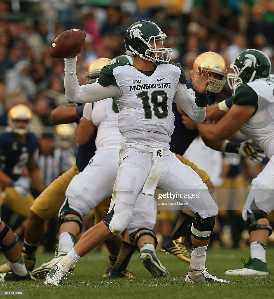 Connor Cook #18 of the Michigan State Spartans passes against the Notre Dame Fighting Irish at Notre Dame Stadium on September 21, 2013 in South Bend, Indiana. Notre Dame defeated Michigan State 17-13.