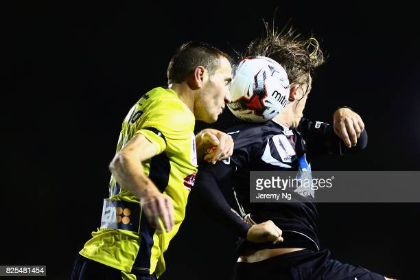 Connor Evans of Blacktown City FC and Alan Baro of the Mariners contest for the ball during the FFA Cup round of 32 match between Blacktown City and...
