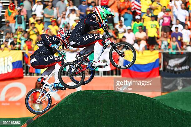 Connor Fields and Nicholas Long of the United States compete during the Men's BMX Final on day 14 of the Rio 2016 Olympic Games at the Olympic BMX...