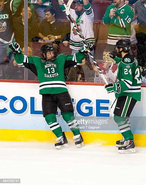 Connor Gaarder of North Dakota celebrates his goal against the Minnesota Golden Gophers with teammate Jordan Schmaltz during the NCAA Division I...