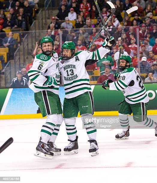 Connor Gaarder of North Dakota celebrates his goal with teammate Paul LaDue against the Boston University Terriers during the 2015 NCAA Division I...