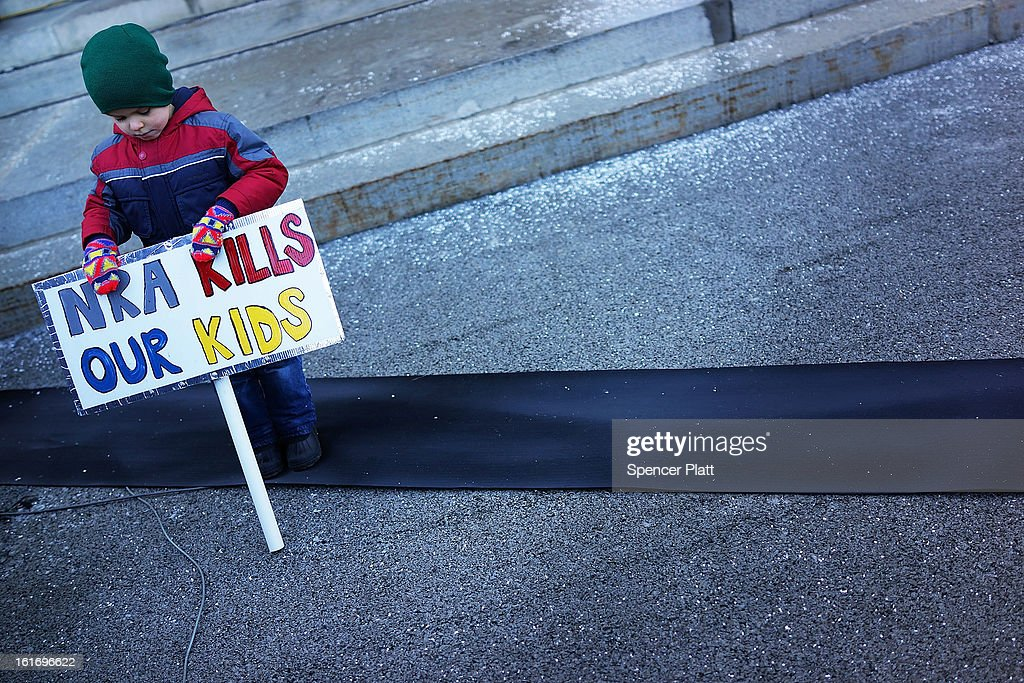 Connor Garrett, 5, holds a sign during a rally at the Connecticut State Capital to promote gun control legislation in the wake of the December 14, 2012, school shooting in Newtown on February 14, 2013 in Hartford, Connecticut. Referred to as the 'March for Change' and held on the two-month anniversary of the massacre in Newtown, Connecticut, participants called for improved gun safety laws. Among the safety measures being demanded are for universal background checks, more work within the mental health community and restricting high-capacity magazines.