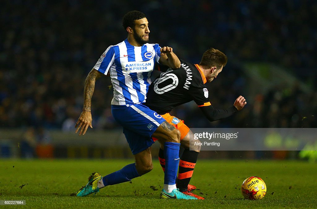 Connor Goldson of Brighton and Hove Albion and Callum McManaman of Sheffield Wednesday clash during the Sky Bet Championship match between Brighton & Hove Albion and Sheffield Wednesday at Amex Stadium on January 20, 2017 in Brighton, England.