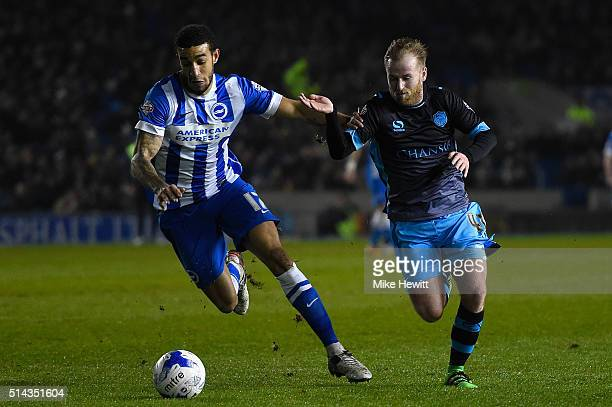Connor Goldson of Brighton Hove Albion holds off Barry Bannan of Sheffield Wednesday during the Sky Bet Championship match between Brighton and Hove...