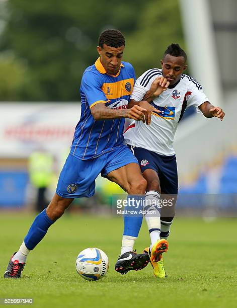 Connor Goldson of Shrewsbury Town and Robert Hall of Bolton Wanderers