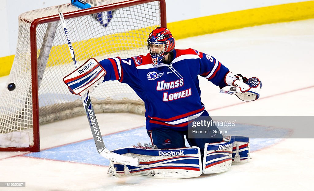 Connor Hellebuyck #37 of the Massachusetts Lowell River Hawks makes a save against the Boston College Eagles during the NCAA Division I Men's Ice Hockey Northeast Regional Championship Final at the DCU Center on March 30, 2014 in Worcester, Massachusetts.