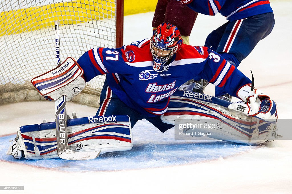 Connor Hellebuyck #37 of the Massachusetts Lowell River Hawks tries to make a save against the Boston College Eagles during the NCAA Division I Men's Ice Hockey Northeast Regional Championship Final at the DCU Center on March 30, 2014 in Worcester, Massachusetts.