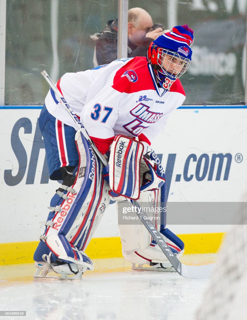 Connor Hellebuyck #37 of the Massachusetts Lowell River Hawks warms-up before NCAA hockey action against the Northeastern University Huskies in the 'Citi Frozen Fenway 2014' at Fenway Park on January 11, 2014 in Boston, Massachusetts.