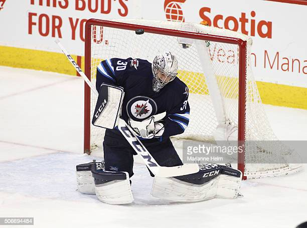 Connor Hellebuyck of the Winnipeg Jets blocks a shot on goal in first period action in an NHL game against the Colorado Avalanche at the MTS Centre...