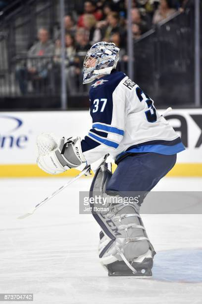 Connor Hellebuyck of the Winnipeg Jets defends his goal against the Vegas Golden Knights during the game at TMobile Arena on November 10 2017 in Las...