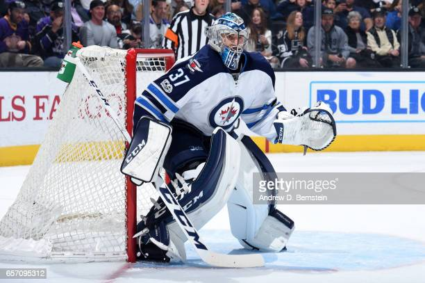 Connor Hellebuyck of the Winnipeg Jets defends the goal during a game against the Los Angeles Kings at STAPLES Center on March 23 2017 in Los Angeles...