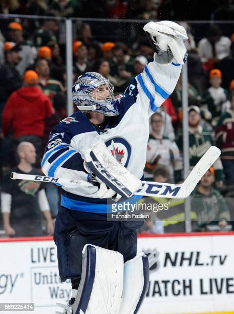 Connor Hellebuyck of the Winnipeg Jets defends the net against the Minnesota Wild during the game on October 31 2017 at Xcel Energy Center in St Paul...
